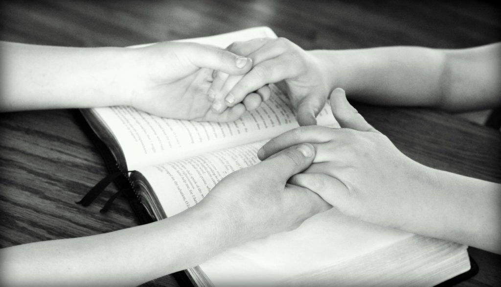 holding hands, bible, praying